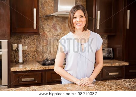 Young Housewife In Her Kitchen