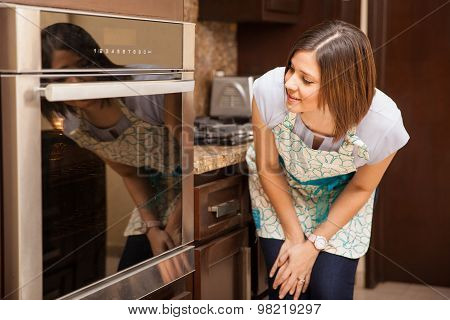 Woman Baking A Cake And Waiting