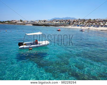 Boat Over Clear Water On Crete Coast, Greece