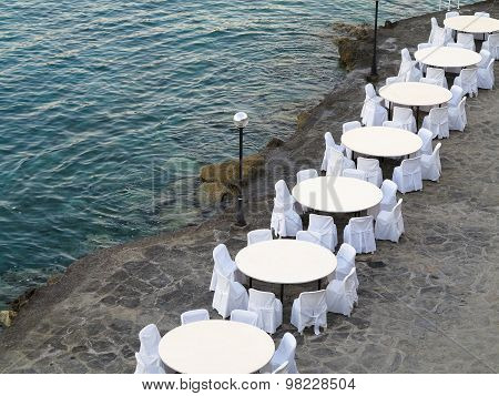 Open Air Restaurant Near Sea, White Chairs And Tables