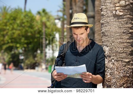 Lost Man With Map And Bag Standing Outside