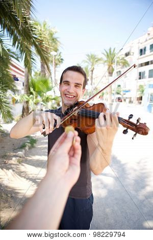 Busker Playing Violin Outside For Money