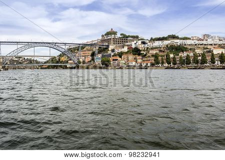 Panoramic From Douro River Tour Boat, View Of Dom Luiz Bridge And Gaia Riverbank, Porto Cityscape.