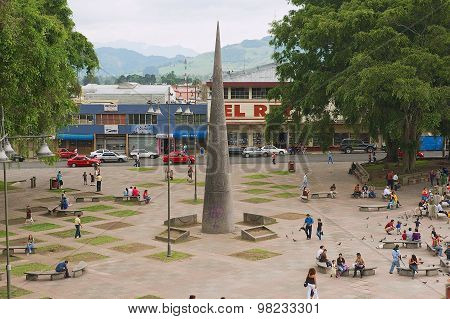 People walk by the Central square in Carago Costa, Rica.