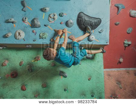 Boy Climbing In Gym