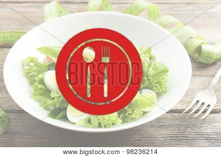 Salad with quail egg and basil in plate on wooden table background