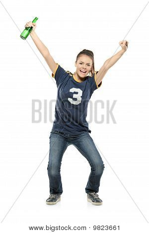 Full Length Portrait Of A Happy Female Sport Fan With A Beer In Her Hand
