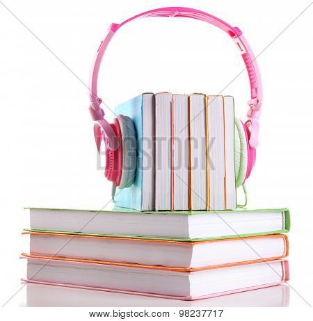 Books and headphones as audio books concept isolated on white