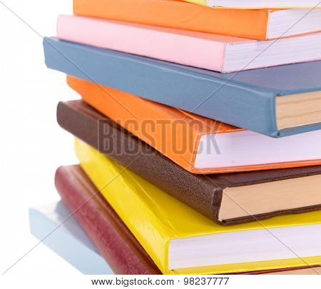 Heap of books on light background