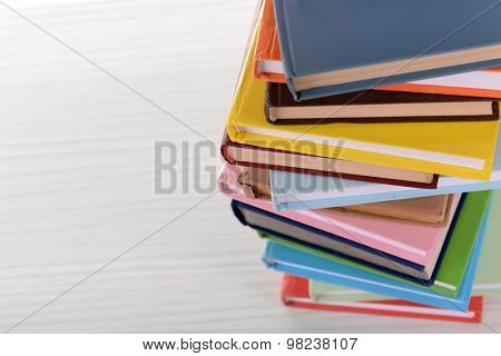Heap of books on table close up