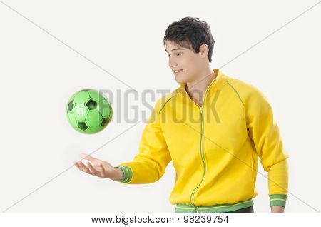 Young Man Throwing A Football Ball.