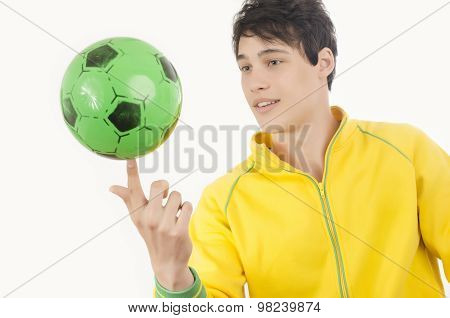 Young Man Playing With A Football Ball.