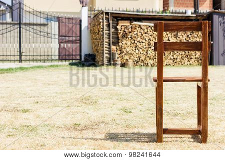 Single Wooden Chair Standing On Withered Grass