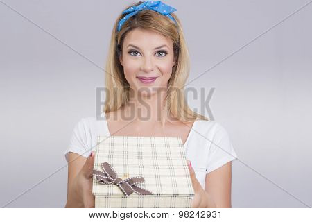 Blonde holding a gift