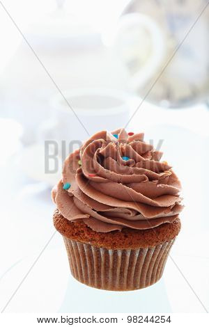 Close Up Of Buttercream Chocolate Cupcake Against White Background