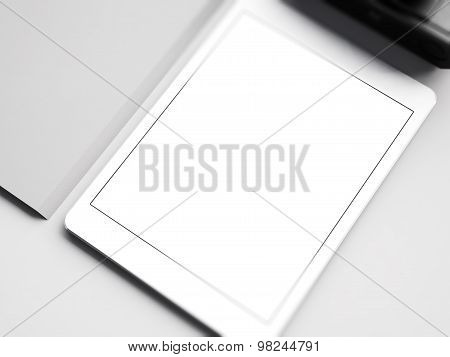 Mock up of white tablet on the workspace. 3D rendering