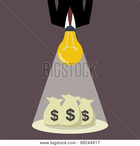 Businessman With A Light Bulb Head Glow To The Money Bags