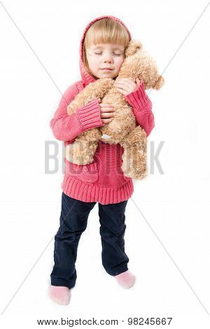 A Little Girl Hugging A Teddy Bear