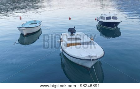 Three Small Fishing Boat In Calm Water