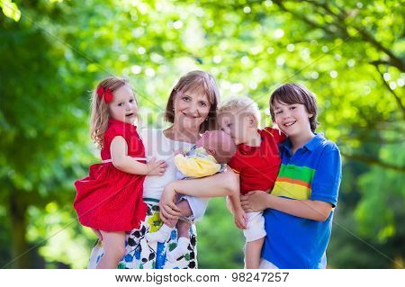 Portrait Of Happy Woman With Four Kids