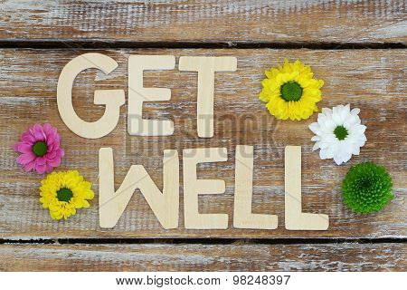 Get well written with wooden letters on rustic wood