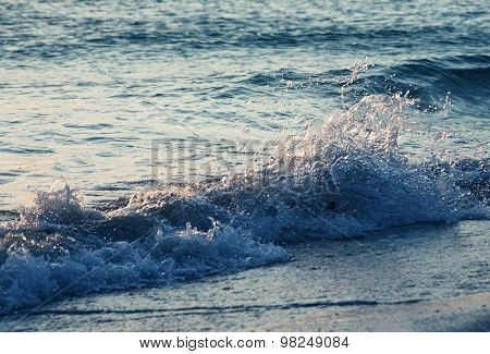 Ocean wave with splashes and bubbles. Cool tone. With backlight