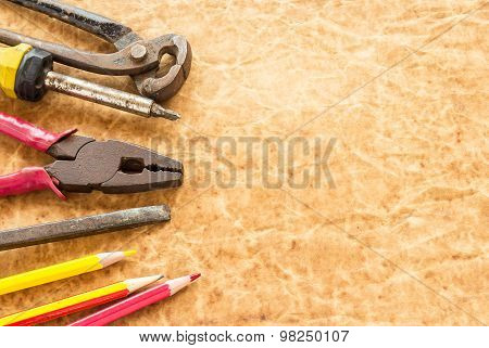 Tools And Pencil On Old Paper Background