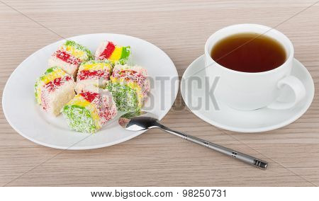 Multicolor Turkish Delight In Plate And Cup Of Hot Tea