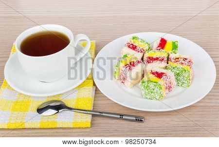 Multicolor Turkish Delight In Plate And Cup Of Tea