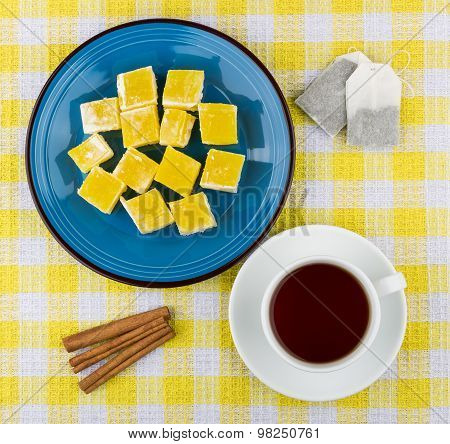 Yellow Turkish Delight In Plate, Cup Of Tea And Cinnamon