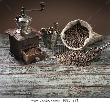 Coffee grinder and sack of coffee beans with space for your text