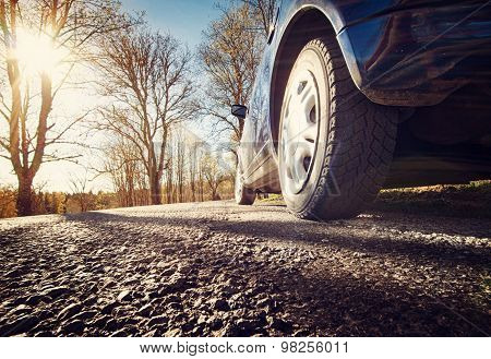 Car on asphalt road in spring morning