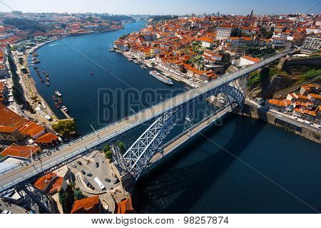 Aerial shot of the metal arch bridge (Dom Luise bridge) between the city of Porto and the city of Vila Nova de Gaia at sunny day. Portugal