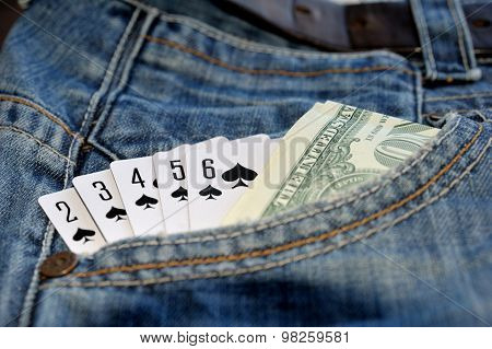 Play Card Straight Flush And Money In  Jean Pocket.