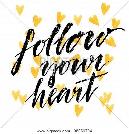 Follow your heart - modern calligraphy phrase handwritten on watercolor golden hearts background.