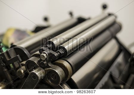 steel cylinders of an old press in a printing shop