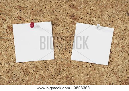 empty paper notes pinned on a cork background