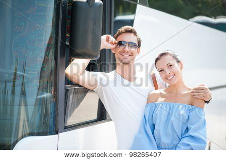 Cute loving couple is using a public transport