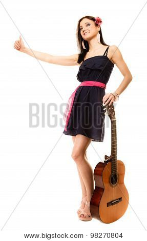Girl With Guitar Thumbing And Hitch Hiking Isolated