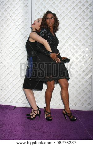 LOS ANGELES - AUG 8:  Amy Yasbeck, Holly Robinson Peete at the 17th Annual HollyRod Designcare Gala at the The Lot on August 8, 2015 in West Hollywood, CA