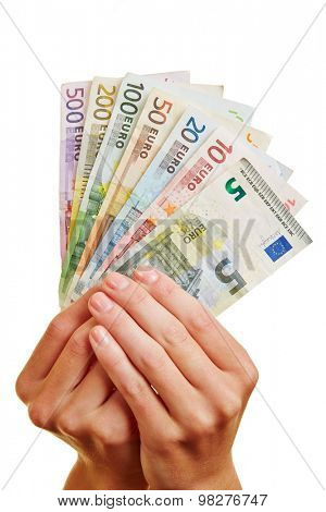 Two hands holding fan of Euro money bills