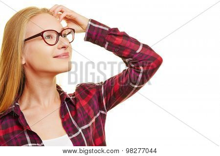 Young blonde woman looking optimistically into the future