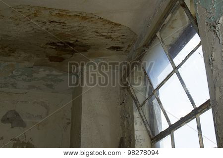 Rusty Window With Chipping Walls And Ceiling