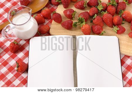 Strawberries With Blank Recipe Book And Red Check Tablecloth