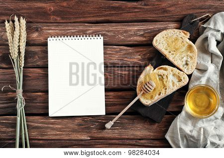 Slices Of Bread With Honey On Wooden Boards On Wooden Background
