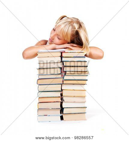 Back to school. Tired Schoolgirl sleeping on a stack of books isolated on a white background. Education concept, knowledge. School girl