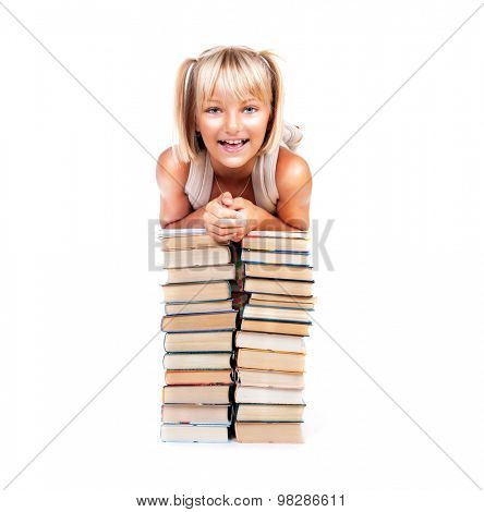 Back to school. Happy Smiling Schoolgirl sits on stacks of books isolated on a white background. Education concept, knowledge. Pretty school girl portrait