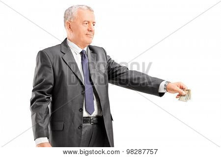 Mature businessman giving money to someone isolated on white background