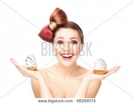 Attractive girl with a bow haircut holding cakes.