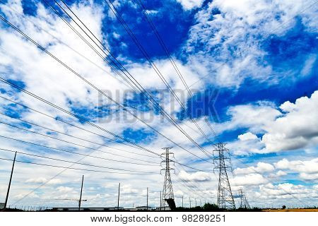 High Voltage Power Lines And High Voltage Poles. Under The Beautiful Sky.